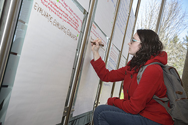 photo of a student writing on a whiteboard