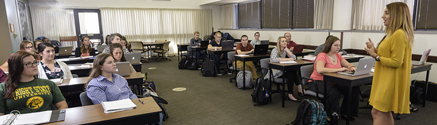 photo of students and a professor in a classroom