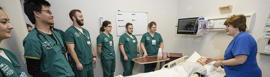 photo of nursing students and an instructor
